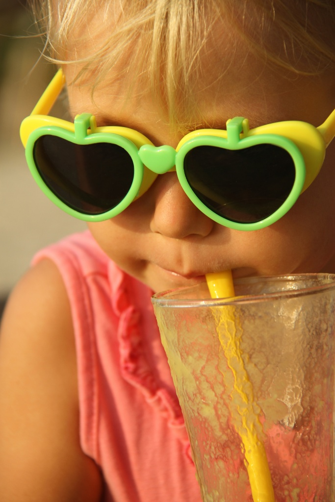 Sweet girl enjoying her delicious smoothie! For recipes and inspiration, go to: www.makeloveinthekitchen.com